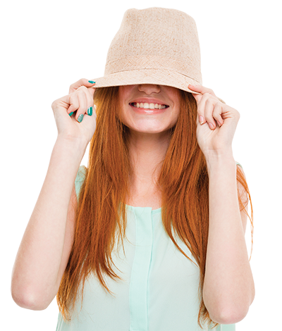 Lady holding hat over her face.